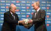 Russia's President Vladimir Putin (R) and FIFA President Sepp Blatter take part in the official hand over ceremony for the 2018 World Cup scheduled to take place in Russia, in Rio de Janeiro July 13, 2014.    (REUTERS/Alexey Nikolsky/RIA Novosti/Kremlin)