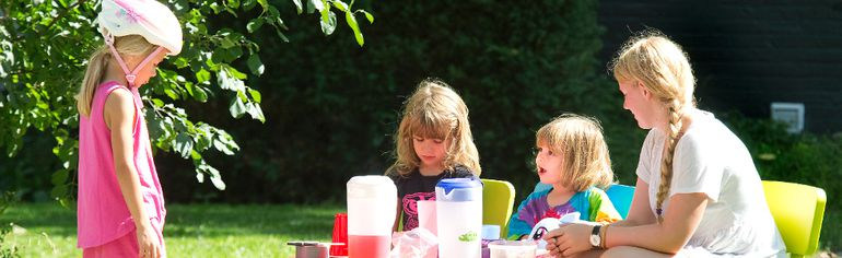 Young Anna McClenaghan gives her sales pitch to Evelyn Helland, 6, at a lemonade stand in London Friday with older sister Ruby and sitter Emma Hamber. Such childish delights in summer's dying days are in sharp contrast to the 25,000 area kids who will arrive at school hungry next week. (DEREK RUTTAN, The London Free Press)