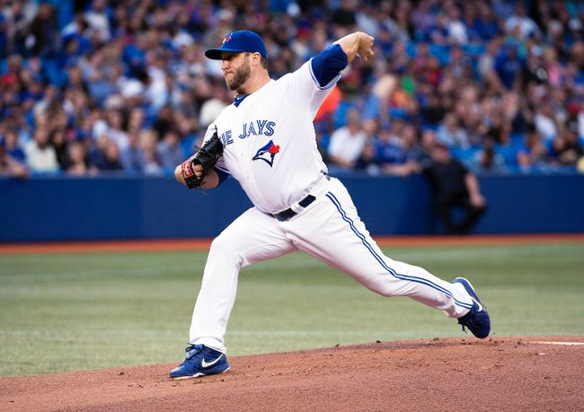 Toronto Blue Jays starting pitcher Mark Buehrle throws against the New York Yankees at the Rogers Centre in Toronto, Aug. 29, 2014. (NICK TURCHIARO/USA Today)