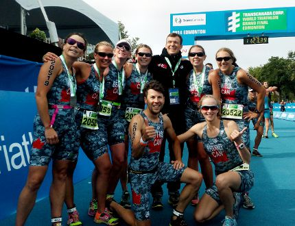 <p>Retired Canadian triathlon superstar Simon Whitfield made a surprise visit at the finish line to greet athletes during early races on Friday August 29, 2014 during the ITU World Triathlon Grand Final at Hawrelak Park in Edmonton, Alta. Photo Courtesy/ITU Media