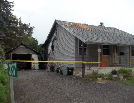 A house on Water Street in Vittoria suffered $130,000 damage in a fire on Friday, August 29, 2014. KIM NOVAK/SIMCOE REFORMER