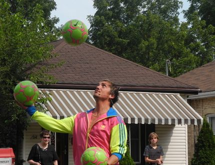Victor Rubilar performs a juggling routine at the Brantford Buskers Festival in Eagle Place on Saturday.