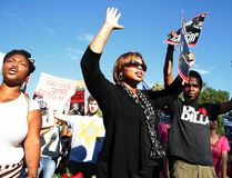 Protesters march with their hands up as they call for a thorough investigation of the shooting death of teen Michael Brown in Ferguson, Mo., on a street in front of the White House in Washington, August 28, 2014. (REUTERS/Larry Downing)