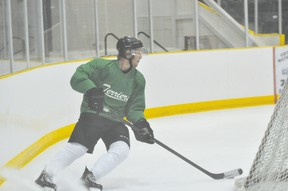 Portage Terriers defenceman Brett Orr takes the puck behind the net during Terriers training camp Aug. 31. (Kevin Hirschfield/THE GRAPHIC)