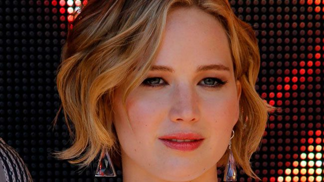 "Cast member Jennifer Lawrence poses during a photocall for the film ""The Hunger Games : Mockingjay - Part 1"" at the 67th Cannes Film Festival in Cannes May 17, 2014. (Chris.K/WENN.com)"
