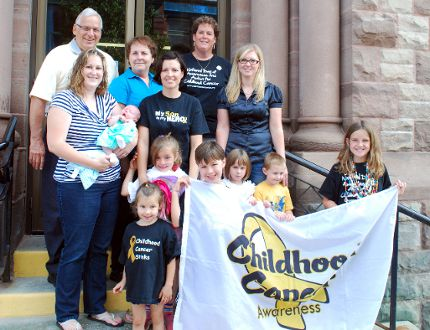 Septmeber is Childhood Cancer Awareness Month. For the firt time ever a flag was raised at Woodstock City Hall to increase awareness of the life changing illness affecting more than 100,000 families today. Several families in the local community are living through the effects of childhood cancer. Some of them gathered Friday for a photo. Back row, left to right, Mayor Pat Sobeski, Anne Marie Droogers, Carolyn Romkes. Middle row, Kaitlyn Gillim, adult survivor of childhood cancer, holding six-week old daughter Sophie Gillim, Tina Smith, Carla Garrett. Front row, Yasmine Smith, 4, Simone Smith, 6, Gabriel Smith, 9, Mackenzie Garrett, 4, Xavier Garrett, 4, and Olivia Romkes, 10. TARA BOWIE / SENTINEL-REVIEW / QMI AGENCY