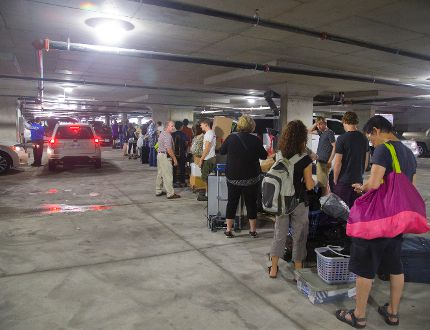 Huge lineups form in the garages beneath the Luxe student building on Richmond St. as Western students move in Monday. (MIKE HENSEN, The London Free Press)