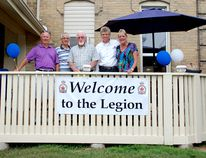 The Kincardine Legion Branch 183 celebrated the new addition of their extended deck on Aug. 30, 2014. Despite grey skies and rainy weather, people filled the deck and packed inside to enjoy drinks, appetizers, and a draw. L-R: Al Bowers, Bill Bowers, Ken Jackson, Harvey de Leeuw, and Legion president Maureen Couture. (LISA UMHOLTZ/KINCARDINE NEWS)