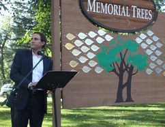 KEVIN RUSHWORTH HIGH RIVER TIMES/QMI AGENCY. Mayor Craig Snodgrass speaks at the 2013 /2014 Memorial Tree ceremony in George Lane Memorial Park. The ceremony returned after having to be cancelled due to the 2013 flood.