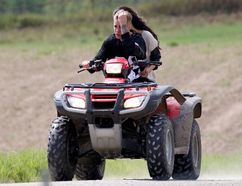 Justin Bieber and Selena Gomez ride an all-terrain vehicle on the back roads near Stratford. Bieber was later involved in a collision with the ATV and charged by Ontario Provincial Police. (Pacific Coast News/Postmedia Network)