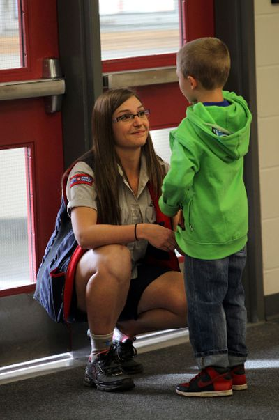 Amy Derksen chats with her son Rylan on the first day of school at Victoria School of the Arts in Edmonton, Alberta on September 2, 2014. Perry Mah/Edmonton Sun/QMI Agency