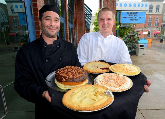 Sous Chef Michael Schuster, left, and Ryan Watson, Western Fair executive chef show five of the pies that will be featured at the Western Fair on Tuesday September 2, 2014. 