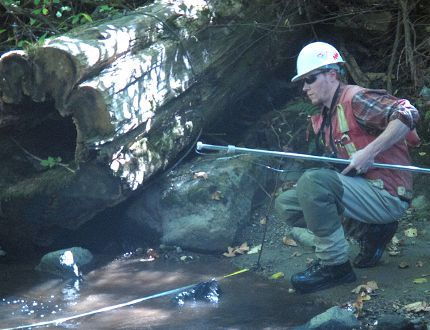 A Kinder Morgan surveyor on City of Burnaby land in August. (FILE PHOTO/24 HOURS)