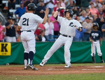 London Majors player Paul Young, right, high fives fellow Majors player Byron Reichstein at home plate after hitting a two-run homer during the first inning of game 7 in their IBL semifinal game against the Kitchener Panthers at Labatt Memorial Park in London, Ontario on Monday August 18, 2014. (CRAIG GLOVER, The London Free Press)