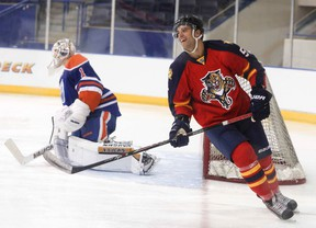Aaron Ekblad, takes a shot at goalie Laurent Brossoit at the Mattamy Athletic Centre on August 23, 2014 in Toronto for the 2014 NHLPA Rookie Showcase. (Veronica Henri/Toronto Sun/QMI Agency)