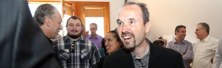 Councillor Bryan Paterson greets supporters on Wednesday before announcing his intention to run to be the mayor of Kingston. (Ian MacAlpine/The Whig-Standard)