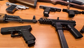 """A display of guns that were seized during Project """"Sleepwalker"""" at a press conference announcing the conclusion of the 18-month drug investigation. Thursday December 8,2011. (ERROL MCGIHON/THE OTTAWA SUN/QMI AGENCY)."""
