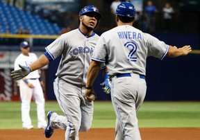 Toronto Blue Jays first baseman Edwin Encarnacion celebrates a hone run against the Tampa Bay Rays with third base coach Luis Rivera at Tropicana Field in St. Petersburg, Fla., Sept. 3, 2014. (KIM KLEMENT/USA Today)