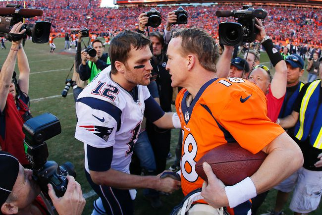 Tom Brady of the New England Patriots congratulates Peyton Manning of the Denver Broncos after the Broncos defeated the Patriots during the AFC Championship game at Sports Authority Field at Mile High on January 19, 2014. (Kevin C. Cox/Getty Images/AFP)