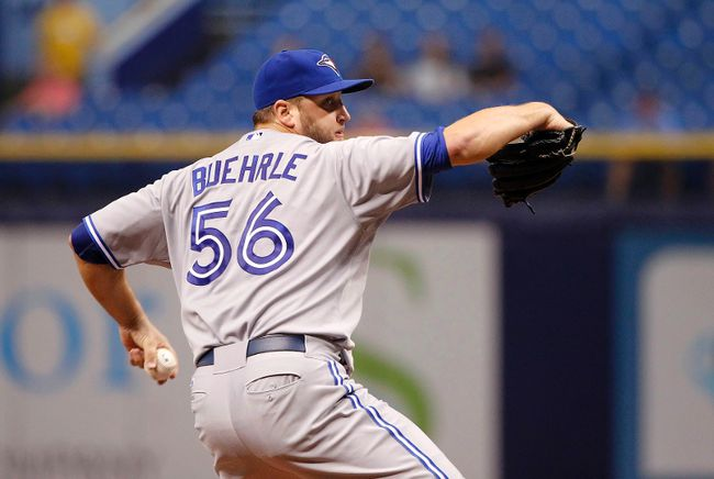 Toronto Blue Jays starting pitcher Mark Buehrle (56) throws a pitch during the first inning against the Tampa Bay Rays at Tropicana Field on Sep 4, 2014 in St. Petersburg, FL, USA. (Kim Klement/USA TODAY Sports)