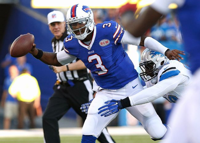 Buffalo Bills quarterback EJ Manuel tries to pass to wide receiver Sammy Watkins under pressure by Detroit Lions defensive end George Johnson during the first half at Ralph Wilson Stadium on August 28, 2014. (Kevin Hoffman/USA TODAY Sports)