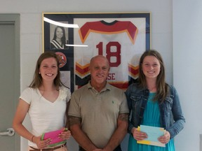 Caitlin Lee, left, and twin sister Erran, right, are co-recipients of this year's Christie Rose Scholarship. Rose, 18, from Fingal, died as a result of injuries sustained in an automobile accident in 2008. The Lee sisters are pictured with Rose's father, Dan. (Contributed photo)