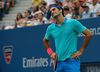 Roger Federer of Switzerland reacts after a missed point against Marin Cilic of Croatia during their semi-final match at the 2014 U.S. Open tennis tournament in New York, September 6, 2014. (REUTERS/Mike Segar)