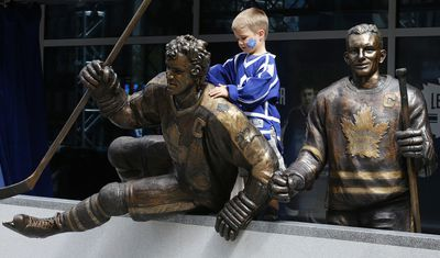 Josh DaSilva ( 5 yrs old)gets a close look at the Sittler staue. A trio of Toronto Maple Leafs greats were the first to be honoured with bronzed statues Saturday. Darryl Sittler, Johnny Bower and Ted Kennedy had their statues unveiled on Legends Row at the team's Fan Fest on Sept. 6, 2014. (Craig Robertson/Toronto Sun)