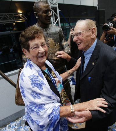 Johnny Bower and  his wife Nancy  have some fun in front of Bower's bronzed statue.  A trio of Toronto Maple Leafs greats were the first to be honoured with bronzed statues Saturday. Darryl Sittler, Johnny Bower and Ted Kennedy had their statues unveiled on Legends Row at the team's Fan Fest on Sept. 6, 2014. (Craig Robertson/Toronto Sun)