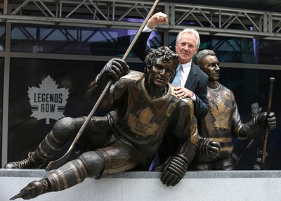 Leaf legend Darryl Sittler with his bronzed statue. A trio of Toronto Maple Leafs greats were the first to be honoured with bronzed statues Saturday. Darryl Sittler, Johnny Bower and Ted Kennedy had their statues unveiled on Legends Row at the team's Fan Fest on Sept. 6, 2014. (Craig Robertson/Toronto Sun)
