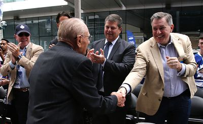 Dave Nonis, and Tim Leiweke shake Johnny Bowers hand at  the ceremony. A trio of Toronto Maple Leafs greats were the first to be honoured with bronzed statues Saturday. Darryl Sittler, Johnny Bower and Ted Kennedy had their statues unveiled on Legends Row at the team's Fan Fest on Sept. 6, 2014. (Craig Robertson/Toronto Sun)