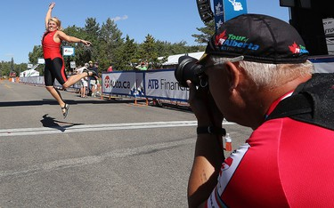 Stephen Middleton takes a photo of Connie Gilson at the Stage 4 finish line during the Tour of Alberta in Sherwood Park Alta., on Saturday Sept. 6, 2014 David Bloom/Edmonton Sun/QMI Agency