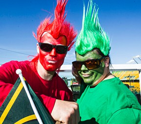 Brent Pickrell, left, from Calgary, and Leah Pickrell, right, from St. Paul, show their colours during the Edmonton Eskimos' CFL football game against the Calgary Stampeders at Commonwealth Stadium in Edmonton, Alta., on Saturday, Sept. 6, 2014. Codie McLachlan/Edmonton Sun/QMI Agency