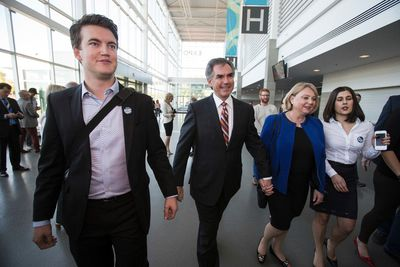 Candidate Jim Prentice (centre) arrives with his wife Karen during the 2014 PC Leadership Vote at the Edmonton Expo Centre in Edmonton, Alta., on Saturday, Sept. 6, 2014. Three candidates, Thomas Lukaszuk, Jim Prentice and Ric McIver are candidates. Ian Kucerak/Edmonton Sun/ QMI Agency
