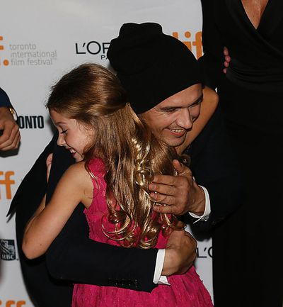 James Franco hugs Stella Allen at the Ryerson Theatre for the red carpet premiere of The Sound and the Fury during the Toronto International Film Festival in Toronto on Saturday September 6, 2014. Michael Peake/Toronto Sun/QMI Agency