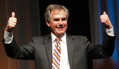 Jim Prentice salutes the crowd as they cheer for him after he was announced as the winner of the 2014 Progressive Conservative Association of Alberta leadership election at Edmonton Expo Centre in Edmonton, Alta., on Saturday, Sept 6, 2014. Tom Braid/Edmonton Sun/QMI Agency