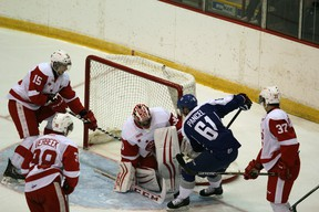 Sudbury Wolves veteran forward Nathan Pancel tries to jam the puck past Soo Greyhounds netminder Joseph Raaymakers during OHL exhibition action at Essar Centre in Sault Ste. Marie on Saturday.