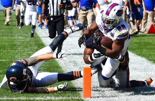 Buffalo Bills running back Fred Jackson (22) rushes the ball against Chicago Bears free safety Chris Conte in overtime at Soldier Field on Sept. 7.