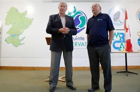 Quinte Conservation general manager Terry Murphy, right, speaks about the Bay of Quinte following a funding announcement by MP Daryl Kramp, Monday.  Emily Mountney-Lessard/The Intelligencer