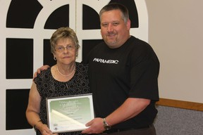 Gord Marsh, director and past president of the Forest and District Agriculture Society, recently presented long-time fair board volunteer Carol Stutt with the OAAS Agriculture Service Award.