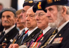 Veteran J. B LeMay, 91, of Ottawa, listens to a speech during a special ceremony to pay tribute to veterans on the 75th anniversary of Canada's engagement in the Second World War. September 10, 2014. Errol McGihon/Ottawa Sun/QMI Agency