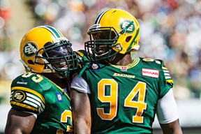 Cameron Sheffield, right, celebrates an interception against Toronto with teammate Rennie Curran at Commonweatlh Stadium Aug. 23. (Codie McLachlan, Edmonton Sun)