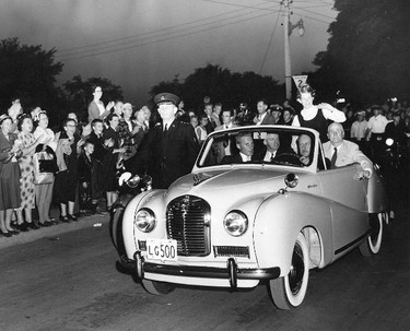 """Of the many gifts well-wishers presented to Marilyn was this baby blue Austin A-40 convertible. I asked her to identify the people in the view. In the back seat are her coach Gus Ryder (right) and CNE President (and former Toronto mayor) Bob Saunders. Up front is newspaper photographer George Bryant and driving was a representative of the Austin car company, a Mr. Michelin. (""""His first name escapes me,"""" she said 60 years after the photo was taken.) Marilyn did recall the quartette was on its way from the CNE Bandshell to the Grandstand where she would be introduced to that year's guest performers Roy Rogers and Dale Evans. While Marilyn was still several miles from shore, these western movie stars asked their audience to pray for the youngster."""