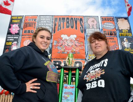 Jessica Kefalidis, left, with her mother Tina Kefalidis, who operates Fatboy's BBQ rig, one of five ribber rigs at the 4th annual Ribfest event in Kelso Beach Park in Owen Sound Saturday. (Scott Dunn/The Sun Times/ QMI)