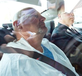 Richard Henry Bain is taken to court in Montreal, Sept. 6, 2012. (PIERRE-PAUL POULIN/QMI Agency)
