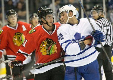 Toronto Maple Leafs' Joshe Leivo and Chicago Blackhawks' Garret Ross exchange insults in the second  period of their game at the 2014 Rookie Tournament in London on Sept. 13.