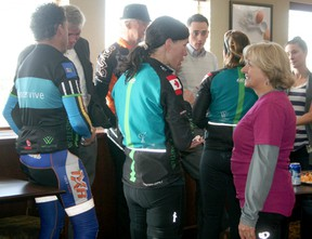 Cancervive riders talk to members of the DV100 organizing committee at a wine and cheese event held to welcome the out-of-town cyclists who stopped in Drayton Valley last week. Twenty-seven riders started a  four-day journey to raise funds and awareness for Wellspring, a support centre for cancer patients.