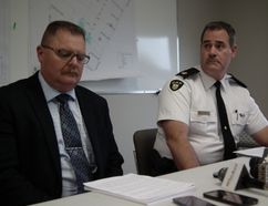 OPP Det. Insp. Chris Avery, left, and Huron OPP Commander Insp. Chris Martin read from prepared statements at press conference on Clinton shooting Sept. 15, 2014. John Miner/The London Free Press