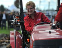 Ontario Premier Kathleen Wynne tries her hand at plowing during the opening day of the International Plowing Match and Rural Expo near Barrie Tuesday, Sept. 16, 2014. (MARK WANZEL PHOTO)
