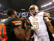 Florida State Seminoles quarterback Jameis Winston (5) meets with Oklahoma State Cowboys safety Larry Stephens (20) after the game at AT&T Stadium on Aug 30, 2014 in Arlington, TX, USA. (Matthew Emmons/USA TODAY Sports)